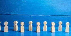 wooden-figures-of-people-on-a-blue-background